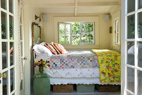 summer cottage bedroom with quilt